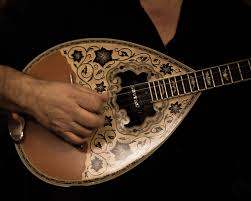 The 'bouzouki', traditional stringed musical instrument.