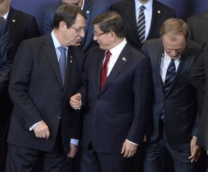 Cypriot President Nicos Anastasiades (L-R), Turkish Prime Minister Ahmet Davutoglu, and EU Council President Donald Tusk line up for the family picture at the start of an EU-Turkey Summit. EPA/STEPHANIE LECOCQ