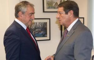 Turkish Cypriot leader Mustafa Akinci (L) - President of the Republic of Cyprus Nicos Anastasiades (R)